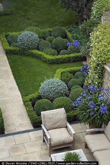 Progettazione giardini la simmetria centro giardino for Topiary garden designs